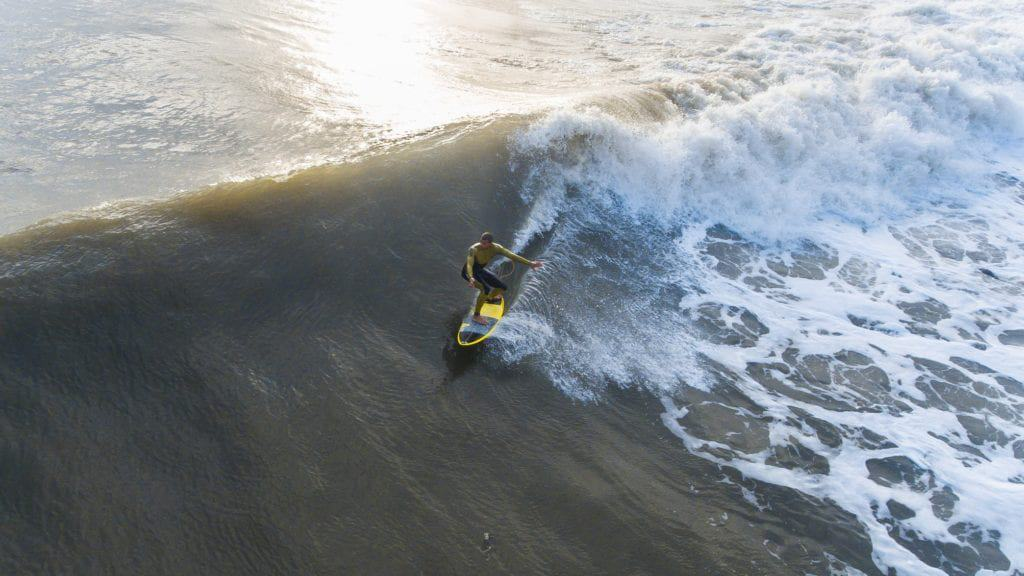 A man riding a wave on a surfboard in the water